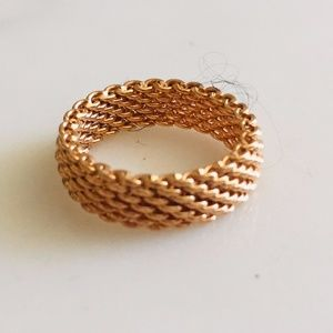 Tiffany Co. stamped 750, 18 kt rode gold mesh band